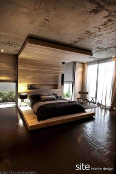 Modern enclosed wood panelled bed.