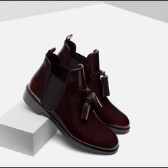 Zara Dark Burgundy Flat Booties with Tassels Worn twice. Looks great and the booties are very comfy. Scratches on the inside as shown in the pictures. No scratches on the outer part of the booties. Says size 40 but I think Zara shoes runs smaller and these booties are more like 9. Zara Shoes Ankle Boots & Booties