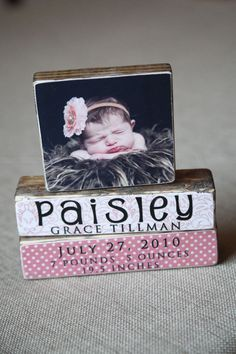 Blocks with image and babies name. can be done with uppercase living!  https://www.facebook.com/Becky.Uppercaseliving