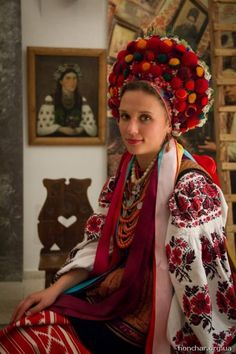 traditional  Ukranian costume ...  вінок ... great photos on this blog ... close ups of the headpiece ... luv the red and black embroidery on the full sleeves ...