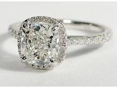 Floating Halo Diamond Engagement Ring in 14k White Gold (1/4 ct. tw.) but maybe with a milgrain frame