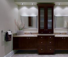 """Scale at its most effective. A """"floating"""" bank of cabinets lends cool serenity to these contemporary bathroom vanities. Wide door frames and reverse-raised panels give Newhaven loads of character and inspire the shape of the elegant center column."""