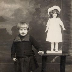 c 1920 rppc SUPER CUTE TODDLER GIRL w FANCY OLD CHINA BISQUE BABY DOLL on STAND. with a doll