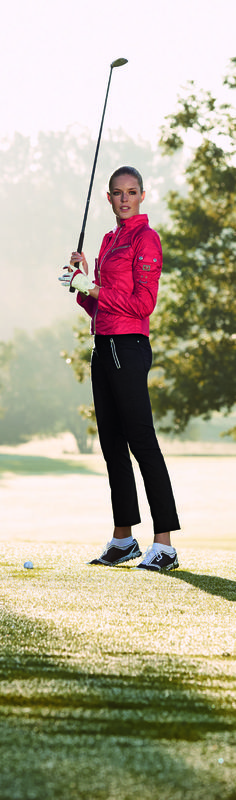 The saturated red hue, an enthralling feminine silhouette, and biker-inspired elements create a true golf favorite.