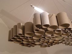These unique carton tube shades are created when recycling meets design. Recycling is a key concept of modern waste management and is the third component of the waste hierarchy. While recycling has grown in general, recycling of specific materials. Cardboard Tube Crafts, Cardboard Rolls, Cardboard Playhouse, Florescent Light Cover, Tube Carton, Recycled Lamp, Diy Karton, Cardboard Furniture, Light Covers