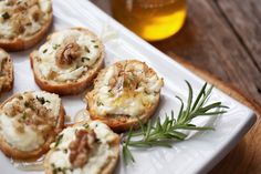 Easy holiday appetizer recipe, this goat cheese crostini recipe features, walnuts, rosemary and a drizzle of honey. Perfect for holiday entertaining.