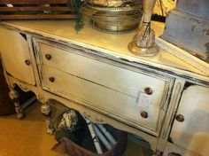 Antique buffet finished in Country Grey Chalk Paint® decorative paint by Annie Sloan along with Clear and Dark Soft Waxes | By Jennifer Roth