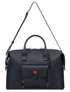 Dior Homme navy blue duffle bag with camouflage accent from Spring/Summer 2016 collection. $3500. 18x12x6.5 in.