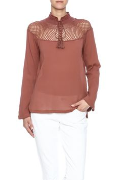 Set up your style and stand apart with the flirty chic top. Crochet-detail stand collar with tassels. Long sleeve flared and slit at cuff.  Top Of The Island by Free People. Clothing - Tops - Long Sleeve Clothing - Tops - Blouses & Shirts Colorado