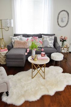 Soft and inviting for spring, this simple blush pillow from HomeGoods set my color choice in the living room. I searched my books for pink jacket covers and found these gorgeous flowers to continue the color theme. Tulips are the ultimate spring flower! The grey floral print pillows soften up the hard lines of the sofa. The furry textures make this living room cozy and welcoming. Sponsored by HomeGoods