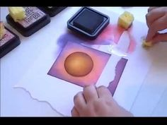 A craft tutorial video demonstrating the use of blending different Distress Inks to create a sunset background. Also shows the finished background combined w...