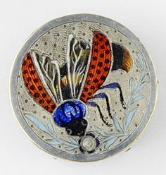 Antique enamel on metal insect button.