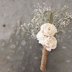 A timeless classic - roses and baby's breathe with a modern twist - these are made from sola wood flowers and twine. The County Class Boutonniere is one of our Deals of the Day! Shop the link in our bio.