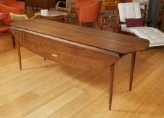 Phillip Lloyd Powell - Drop Leaf Dining Table  HEIGHT:29 in. (74 cm) WIDTH:7 ft. (213 cm) DEPTH:47.75 in. (121 cm) Price Upon Request
