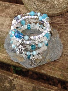 Angels Watch Over Me: five wrap memory wire beaded bracelet with metal stamped charm on Etsy, $40.00