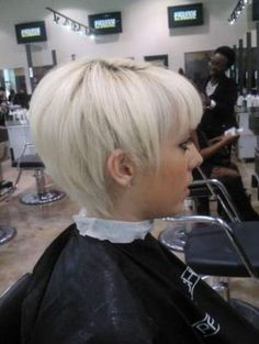 Ideas for when I have hair again.   stacked with v shaping in front of ears with a bang and ALOT of texturizing (she looks to have thin hair)