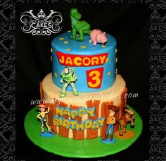 Toy Story(TM) cake featuring toy figures provided by client (purchased at The Disney Store).