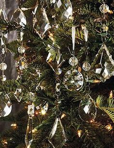 Dress your tree in dazzling sparkle this Christmas with the Set of 24 Crystal Droplets with Silver Hangers that features five uniquely brilliant designs.