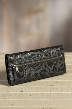 As a feminine clutch or a wallet, the Italian leather with embossed floral motif is a tri-fold showpiece that carries it all. Made in the USA