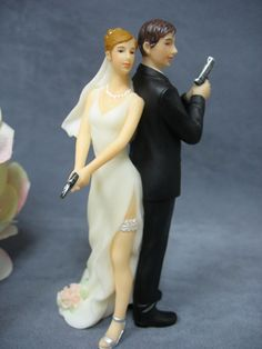 groom bride wedding reception cake top funny humorous hand guns target secret agent bullets Smith Wesson