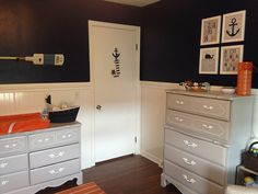 Vintage dresser and chest of drawers painted gray in a nautical nursery