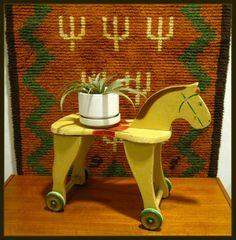 Vintage wooden horse on wheels.