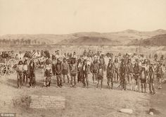 This picture of the Miniconjou Sioux band was taken near the site of the Wounded Knee massacre one month before the December 1890 massacre where hundreds of Indians were killed. (Photographer unknown / No date / Original)