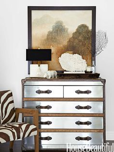 Every room contains at least one statement piece, like Williams-Sonoma Home's Drummond armchair, covered in zebra-print cowhide, next to a vintage chest of drawers.