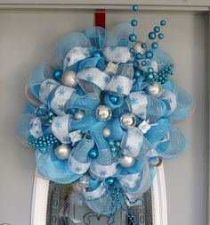 Light Blue Deco Mesh Wreath, Snowflake Wreath. $80.00, via Etsy.