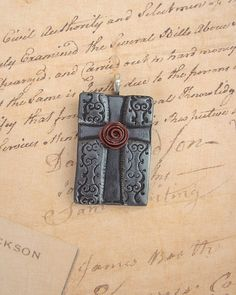 Hey, I found this really awesome Etsy listing at https://www.etsy.com/listing/158821699/rustic-chic-polymer-clay-cross-pendant
