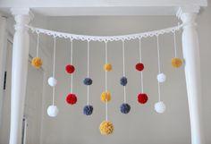A little pom pom garland to brighten up the entrance. (Janine Vangool, UPPERCASE)