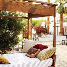 An outdoor Moroccan-style day bed beckons at balmy Korakia Pensione in Palm Springs.