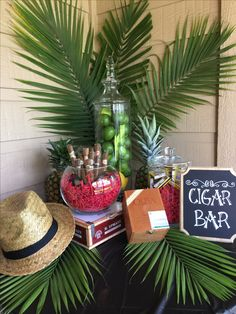 DIY Cigar Bar Havana Nights Cuban themed birthday party assorted cigars limes Chalkboard diy sign cigar boxes Fedora Palm Cigars Matchboxes and Cutters . Big hit with our guests served mojitos and Cuba Libre drinks. Cuba birthday party Havana Nights Theme DIY CIGAR BAR