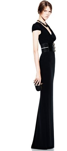"""Everyone has the short black dress but what about """"THE"""" black dress. Floor length dresses with a plunging neck lines are always a great statement made but lets leave the thin straps or neck tied ones and find one with a little sleeve that makes the look more structured and refined. Also adding a waist cinching belt helps with those problem areas around your waist."""