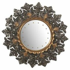 "Wall mirror with a scrolling acanthus leaf-shaped frame.   Product: Wall mirrorConstruction Material: PU, MDF and mirrored glassColor: Antiqued goldDimensions: 36"" Diameter x 1.5"" D"