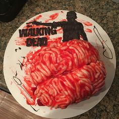 Red Velvet Brain Cake, used rolled fondant for brain wrinkles, printed TWD logo from pic online and covered with wax paper, traced with Wilton black candy melts with a little paramount crystals.
