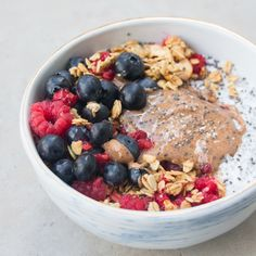 Chia pudding with coconut yoghurt, almond butter, fresh berries and nutty granola