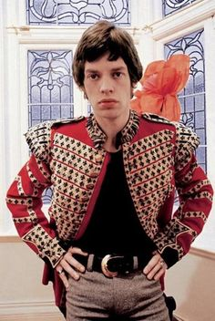 Mick Jagger wearing a Grenadier Guardsman Drummer's jacket from I Was Lord Kitchener's Valet, London, 1960s.