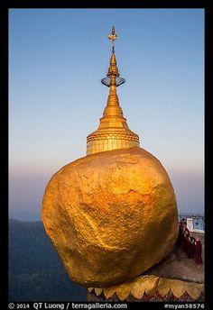 Monks standing in prayer near the Golden rock at sunrise. Kyaiktiyo, Myanmar