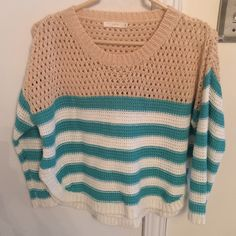 Lush knit sweater Super soft knit striped sweater. Tan with turquoise and white stripes. Has small side slits on each side. Really soft material. Only worn once. Lush Sweaters Crew & Scoop Necks