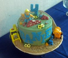 Bob the builder cake. Bob and his friends are made of modeling chocolate.