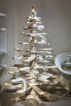 Build a modern tree out of scrap wood planks and decorate it with faux candles and beautiful glass ornaments. Trust us, you won't miss the real thing (or the mess it leaves behind).