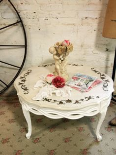 Painted Cottage Chic Shabby White Romantic French Coffee Table. $225.00, via Etsy.
