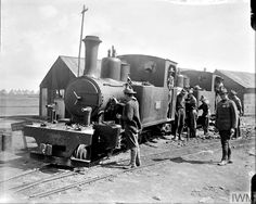 WWI, 2 Sept Troops of the railway regiments, the US Army Corps of Engineers, at the light railway works at Boisleux-au-Mont. © IWM (Q World War One, First World, Rail Transport, Steam Railway, Army Corps Of Engineers, Rolling Stock, Steam Engine, Steam Locomotive, Us Army