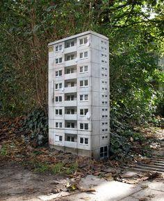 German street artist EVOL transforms banal urban surfaces into miniature lifelike buildings, mostly hi-rise apartment buildings.