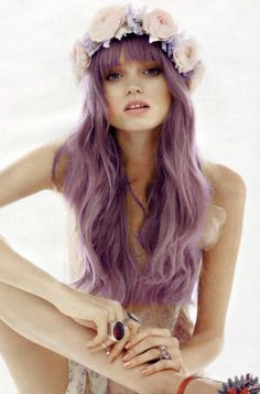 Long wavy pastel violet colored hair with straight wispy bangs and a flowered crown head band