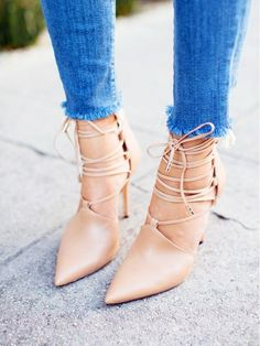 Nude lace-up heels are worn with skinny jeans with frayed hems