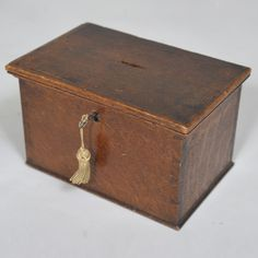 """Early 19th century Oak Money or collecting box with key  Width: 10"""" / 26 cms Depth: 6.5"""" / 16 cms Height: 6"""" / 15 cms"""