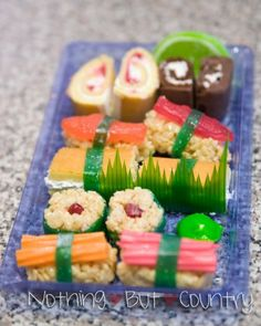 "dessert sushi dessert sushi ~ fun and fabulous! cut up ho-ho's, strawberry rolls, etc., and then shape rice crispie treats around candy and use fruit-by-the-foot as the ""seaweed"" wrap! Dessert Sushi, Sushi Cake, Sushi Party, Sushi Set, Fruit Sushi, Veggie Sushi, Nigiri Sushi, Sashimi, The Menu"