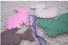 TODDLER TIME ACTIVITY: ANIMAL LACING CARDS = punch cards from heavy card stock, or even better, colorful plastic pieces from assorted packaging: milk cartons, plastic lids, etc (much more durable). Use plastic lacing material- it will be easier to poke through the holes.     http://secondstorywindow.typepad.com/home/2011/10/toddler-time-busy-bag-series-part-2.html